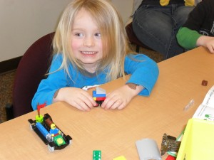 "Quinn, 3, ""My race car and monster truck"""